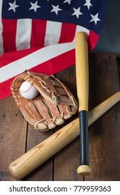 Baseball bat and glove on American flag