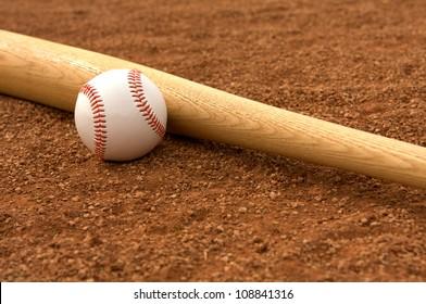 Baseball & Bat on the Infield Dirt