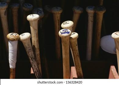 Baseball bats standing on end