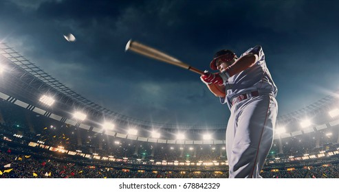Baseball batter hitting ball during game on the professional stadium full of people. The stadium is made in 3D with animated crowd.