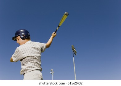 Baseball batter warming up in before match, (low angle view)