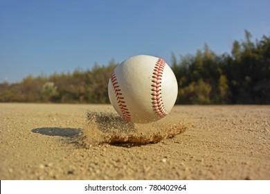a baseball bouncing