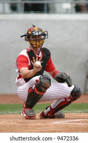 Baseball catcher in red pinstripe uniform