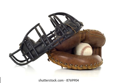 Baseball Catcher's gear on white background including a mitt, ball and face mask