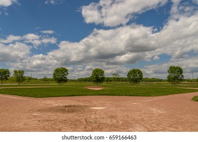 Baseball diamond on a cloudy summer day
