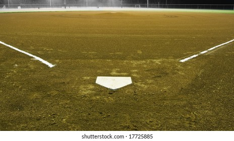 Baseball diamond, view from home plate, under the night time lights