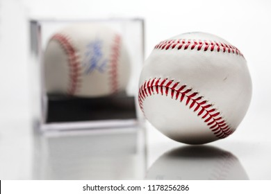 Baseball With Display Case Autographed Memorabilia Blurred In Background Isolated On White