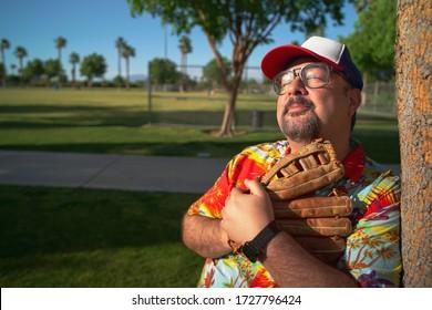 Baseball Fan Wearing Baseball Glove At A Baseball Park