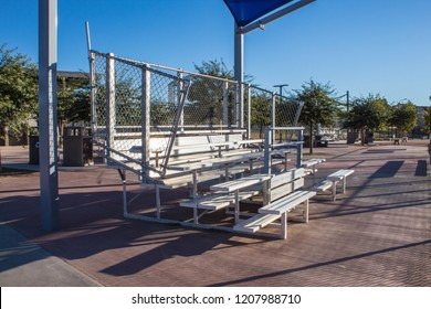Baseball field bleachers under sunny blue sky