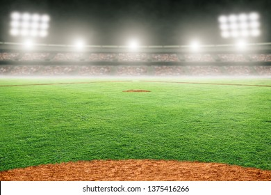 Baseball field at brightly lit outdoor stadium. Focus on foreground and shallow depth of field on background and copy space.