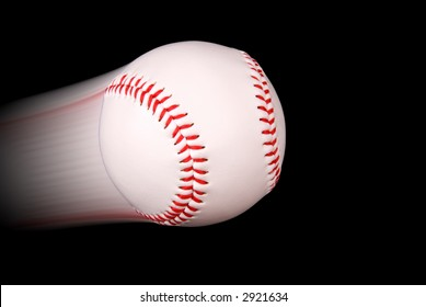 Baseball flying through the air isolated on black background