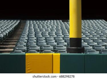 Baseball foul pole with stadium seats.