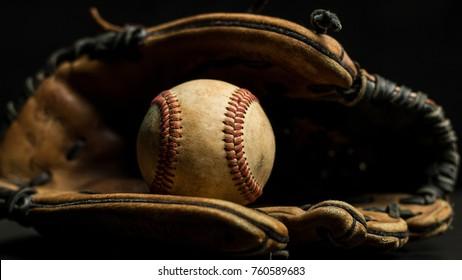 Baseball Glove And A Ball On Black Background