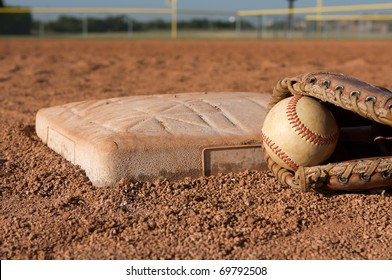 Baseball and glove by second base