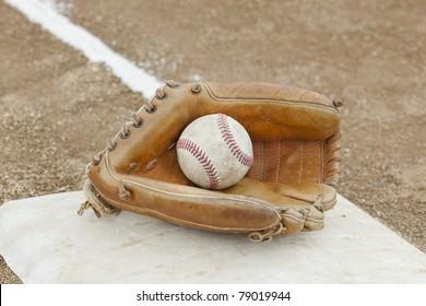 A baseball glove  in a baseball field