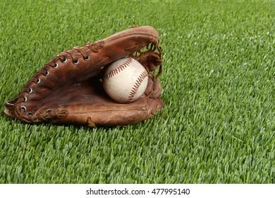 baseball glove and hard ball