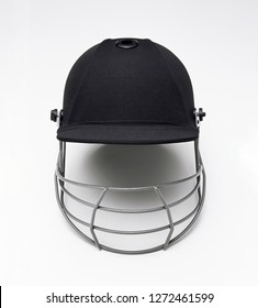 Baseball hat with protective cage on white background