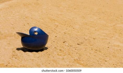 Baseball Helmet on the infield in sand