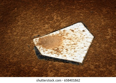 Baseball home plate base in rich fresh dirt