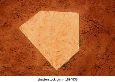 Baseball homeplate in red clay.