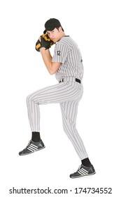 Baseball: Man Winding Up To Pitch Ball