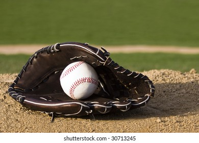 Baseball and mitt on the field