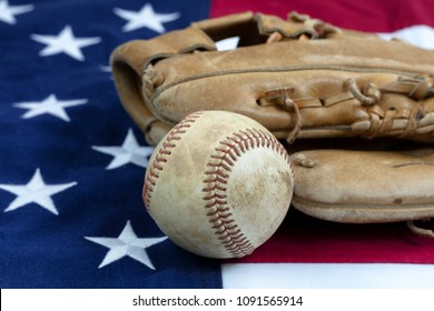 Baseball and mitt with United States flag in background