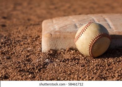 Baseball near a base in the infield
