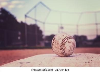 Baseball on a base. Vintage Instagram effect.