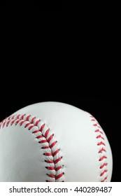 Baseball on black background