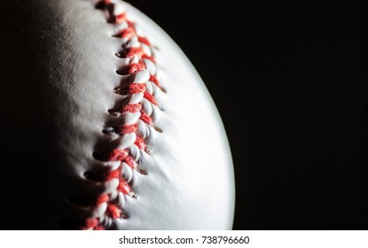 baseball on a black background in a macro, free space
