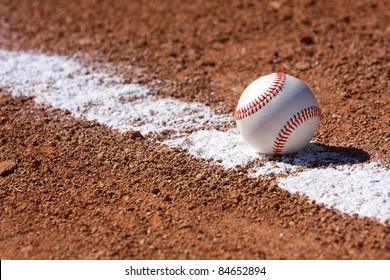 Baseball on the Chalk Line of the Infield with room for copy