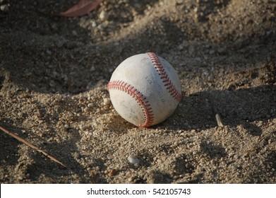 Baseball on dirt/sand