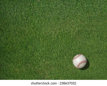 Baseball on green sports turf grass.
