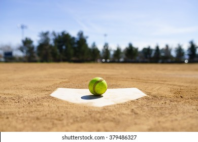 Baseball on a home plate in a baseball field in California mountains, Softball field