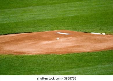 A baseball on a pitchers mound