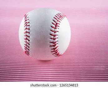 Baseball over pink background, strict close up