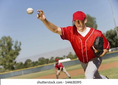 Baseball pitcher throwing a ball