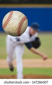 Baseball Pitcher Throwing focus on Ball