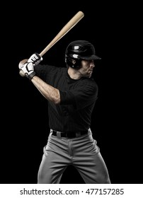 Baseball Player with a black uniform on a black background.