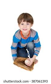 Baseball player: child catching a baseball in a mitt