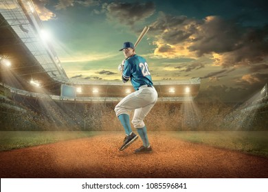 Baseball player in dynamic action on the stadium under sunset sky.