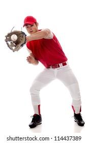 Baseball player fielding. Studio shot over white.