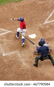 Baseball player gets a hit with a big swing; these are relatively unknown semi-pro 'C' players trying to get to the big leagues. About 1% get there from here.