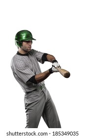 Baseball Player in a Green uniform, on a white background.