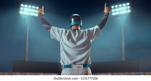Baseball player happy emotionally rejoices in victory on professional baseball stadium