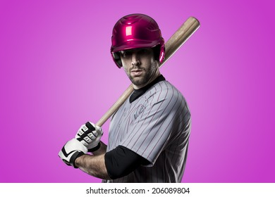 Baseball Player on a pink Uniform on pink background.