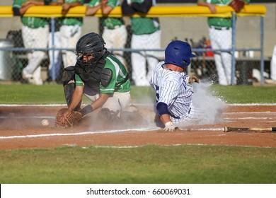 Baseball player Sliding Home