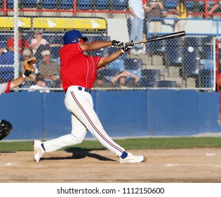 Baseball player swings at a pitch