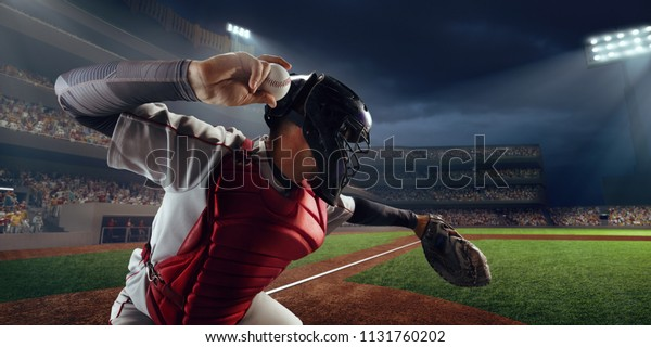 Baseball player throws the ball on professional baseball stadium